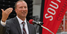 Male athletic director gives speech.