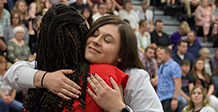 nursing student hugs nursing faculty at pinning ceremony