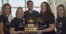 sputum bowl winners hold their trophy