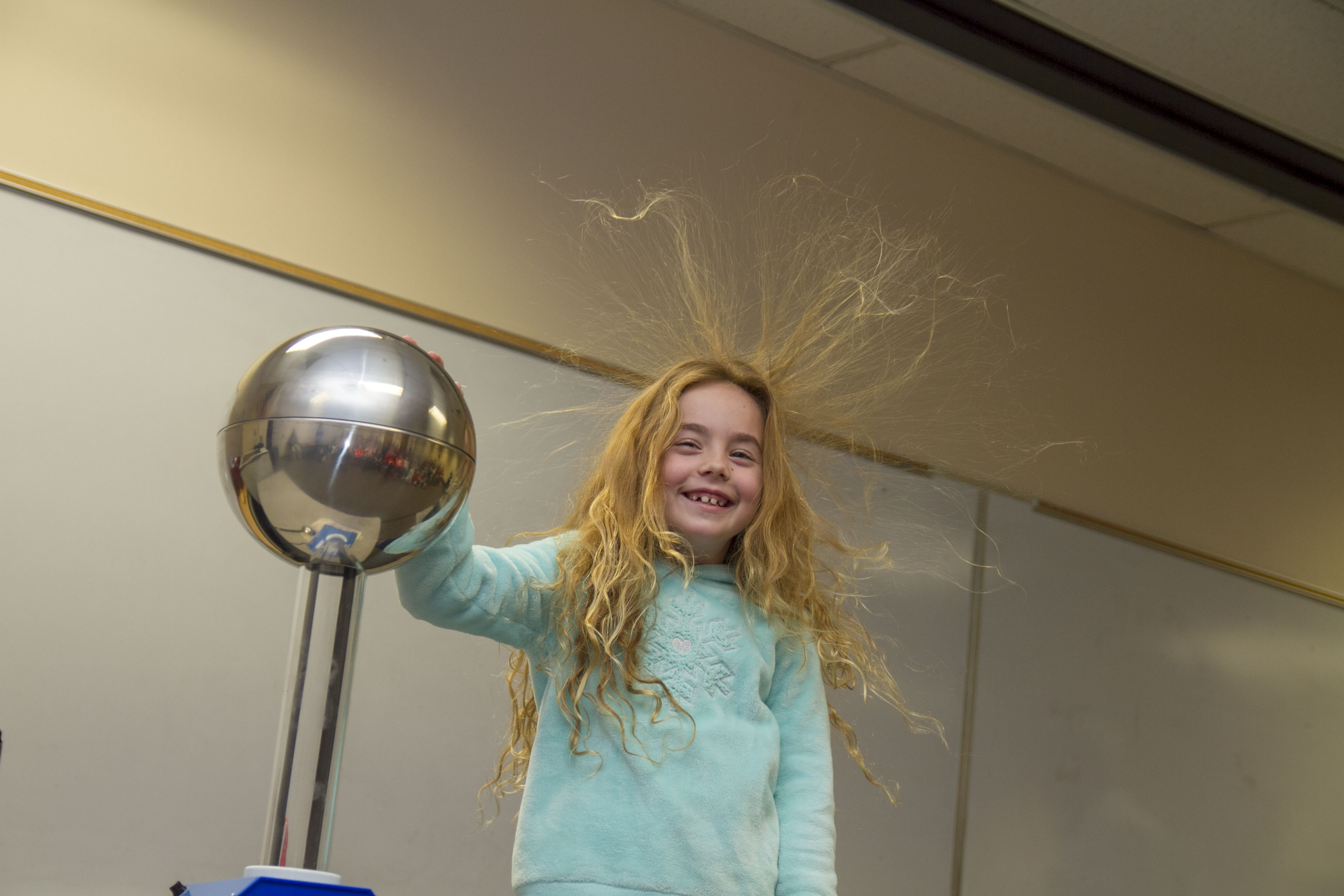 Kids enjoy Absolute Science and the popular static electricity trick.