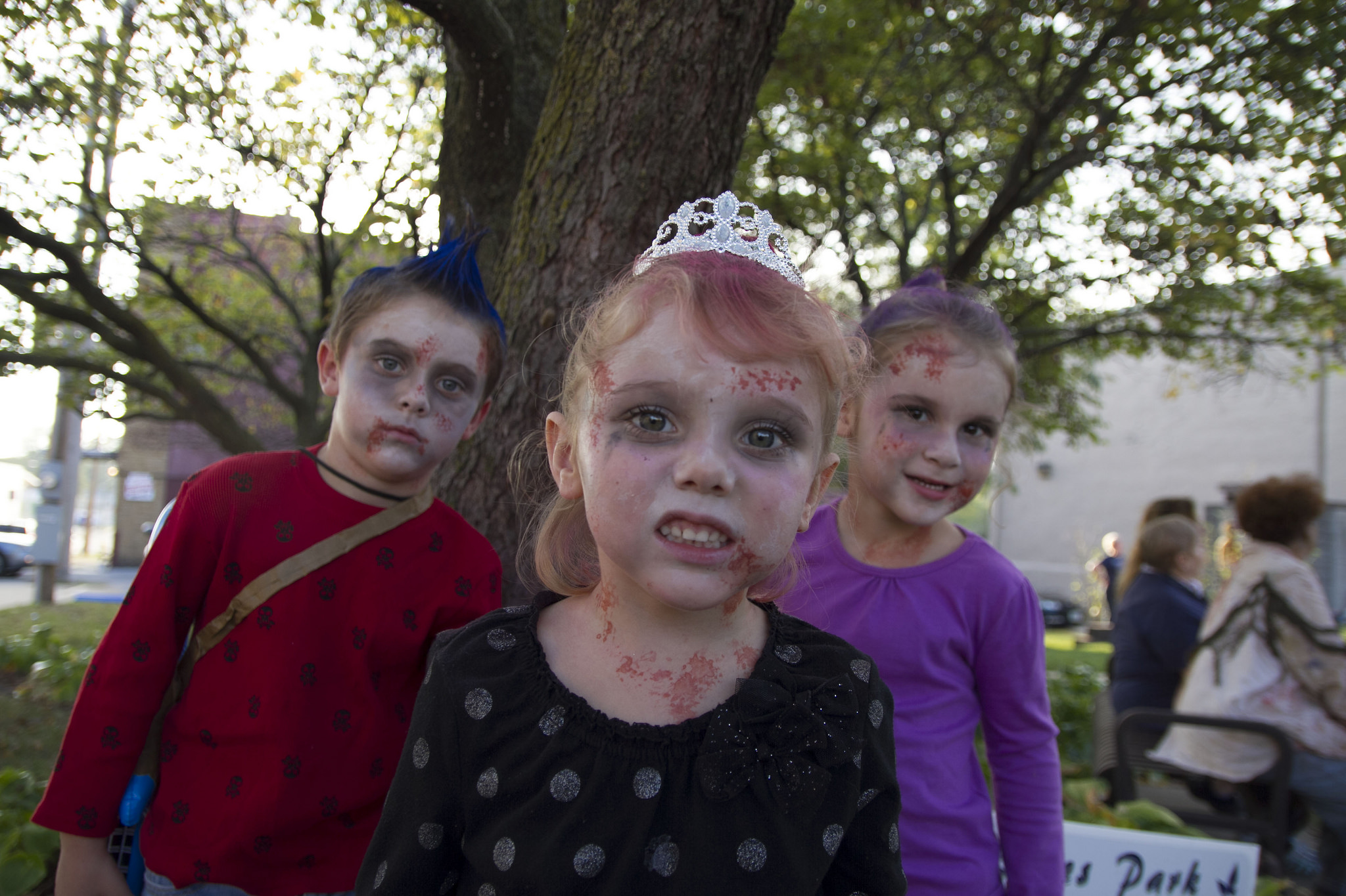 Three children dressed as zombies